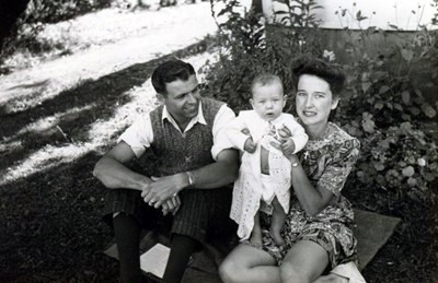 A lovely family photo of Lorne at 6 months of age having summer picnic with his parents, Coral and Nick.