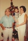 En las Navidades junto a su esposo, muy feliz con su 1er nieto