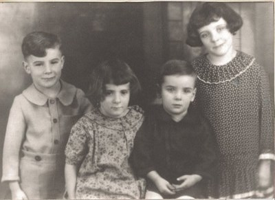 Corinne with her siblings.  From left:  Orville, Corinne, Richard and Betty. Not pictured: Gene.