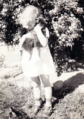 Judy with her two kittens and old mother cat at her feet.